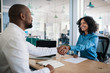canvas print picture - Smiling manager shaking hands with an applicant after an interview