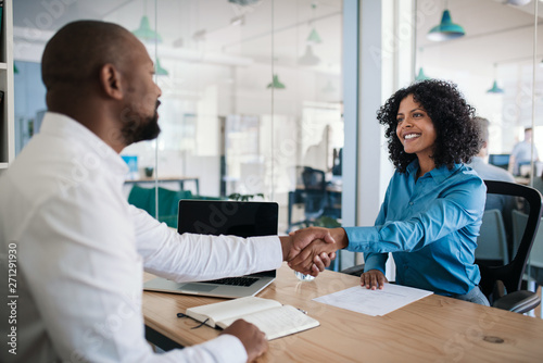 Smiling manager shaking hands with an applicant after an interview