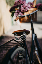 Bicycle With With Fresh Bread And Flowers In A Basket