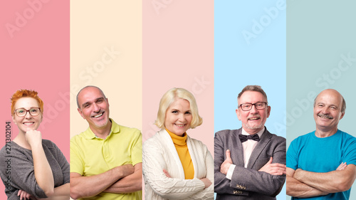 Obraz na plátně  Collage of senior confident smiling men and women posing with folded arms on colored background