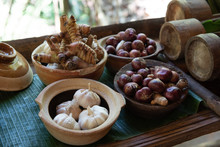 Garlic,okra Or Lady Finger In Bamboo Bowl With Natural Background.