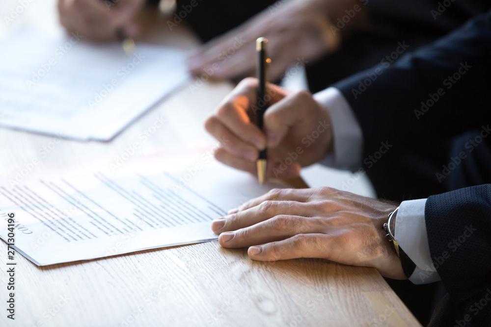 Leinwandbild Motiv - fizkes : Close up of businessmen sign business contract after briefing