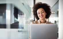 Young African American Woman Working With Tablet In Office