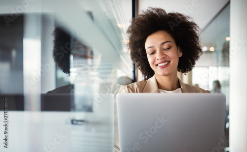 Obraz Young african american woman working with tablet in office - fototapety do salonu