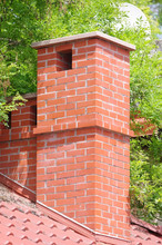 Brick Smokestack On The Roof O...