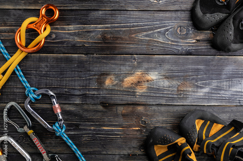 Obraz Climbing gear, equipment belaying carabiners, loops, ropes, climbing shoes - fototapety do salonu