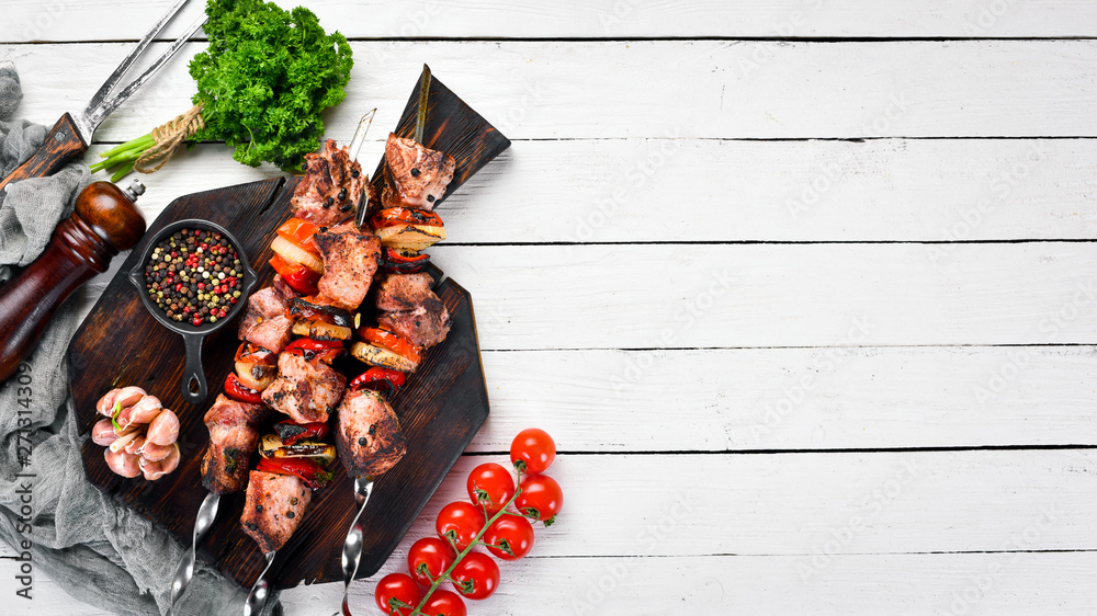 Fototapety, obrazy: Pork shish kebab with onions and tomatoes. Barbecue. Top view. Free space for your text. Rustic style.