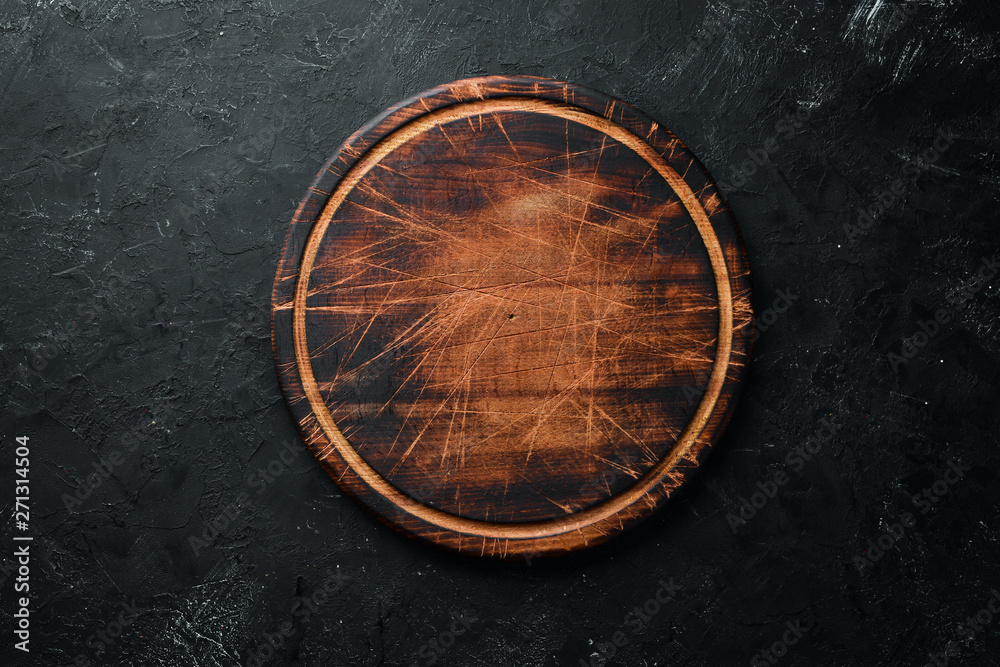Fototapety, obrazy: Old Wooden kitchen board on a black background. Top view. Free space for your text.