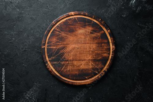 Fotomural  Old Wooden kitchen board on a black background