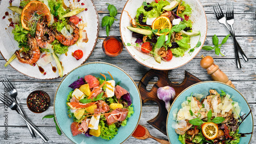 Fototapeta A set of salads. In the plate. Rustic style. Top view. Free space for your text. obraz
