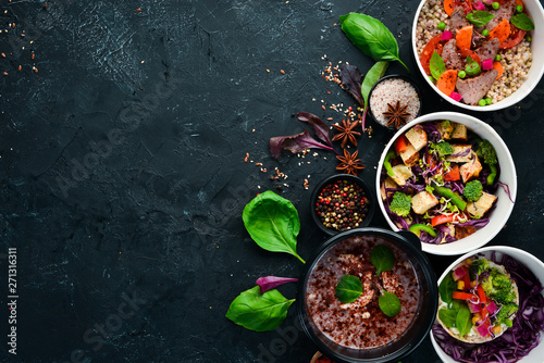 Food with delivery. A set of dishes for the diet. Top view. Free space for your text. On a black background.