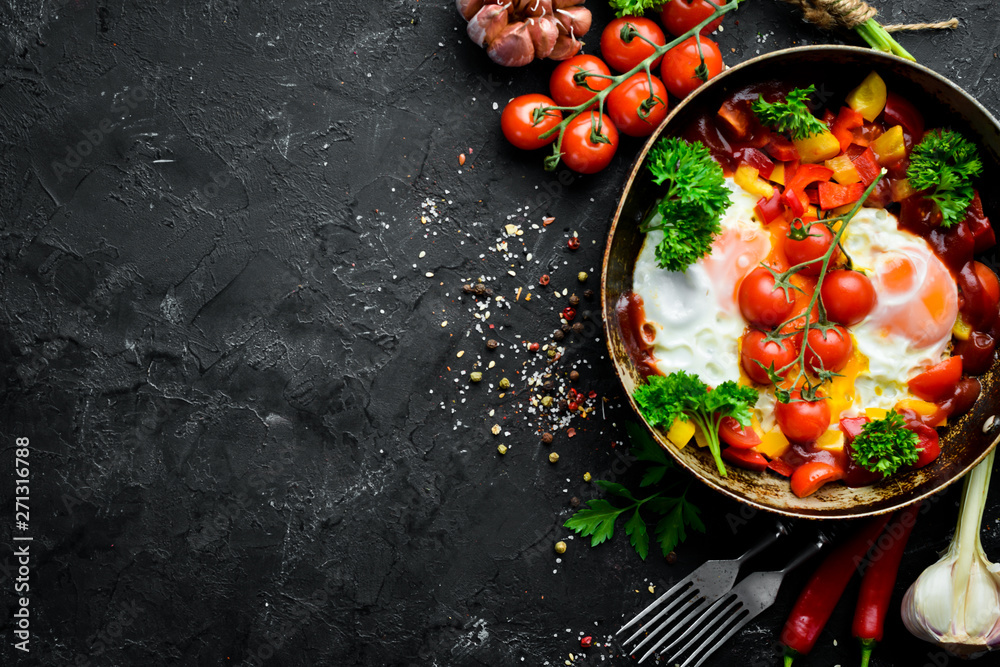 Fototapety, obrazy: Shakshuka Eggs with tomatoes and vegetables in a frying pan. Breakfast. Top view. Free space for your text.