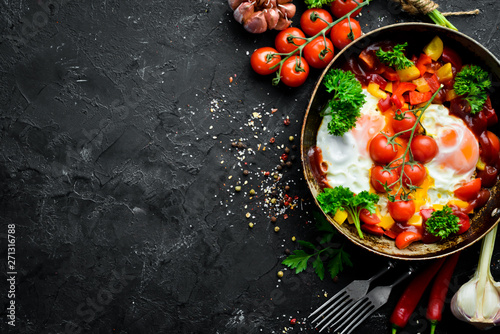 Shakshuka Eggs with tomatoes and vegetables in a frying pan Canvas Print