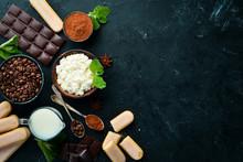 Tiramisu Dessert. Ingredients For Tiramisu Preparation. Top View. On A Black Stone Background. Free Space For Your Text.