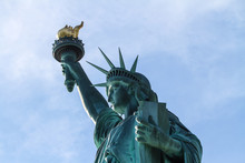 Statue Of Liberty In New York With Torch And Tablet - Close Up From Side With Blue Sky