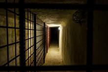 The Dark Prison Corridor Leads...