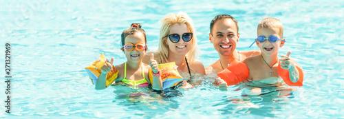 Obraz Happy family in swimming pool at water park - fototapety do salonu