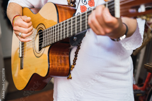 Close-up of cuban woman playing the guitar in the streets of La Havana,Cuba. Selected focus - 271331718