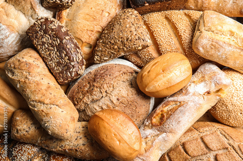 Foto op Canvas Bakkerij Different kinds of fresh bread as background, top view
