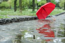 Open Umbrella On City Street, ...