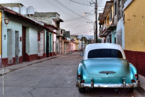 Old blue american car parked in the street of Trinidad, Cuba