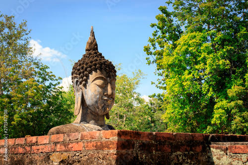 Buddha head stucco at the ruins in Sukhothai historical park in Thailand, Buddha statue, Old Town,Tourism, World Heritage Site, Civilization,UNESCO.