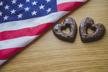Two Heart Shaped Biscuits And Usa Flag On Wooden Table Happy Memorial Day.