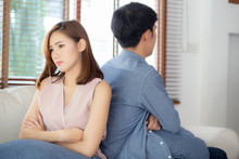 Relationship Of Young Asian Couple Having Problem On Sofa In The Living Room At Home, Family Having Conflict Argument With Unhappy, Man And Woman With Issue, Failure And Stress Together.