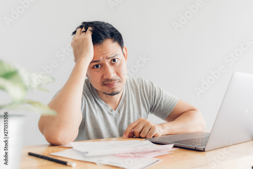 Photo  Sad man has problems with billing and debts.