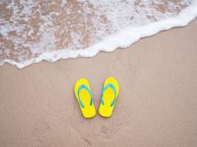Yellow Sandal On Beige Sand Su...