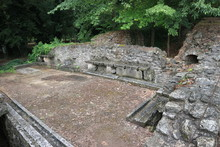 Ruins Of The Ancient Greek Bath With Stone Bench, Archaeological Site Dion, Greece