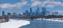 Partially Frozen Mississippi River And Minneapolis Downtown During Winter