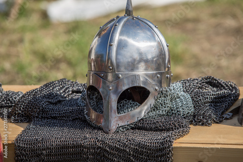Photo Protective helmet with a visor on medieval knight
