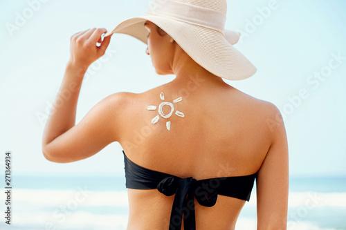 Beauty Woman with sun-shaped sun cream
