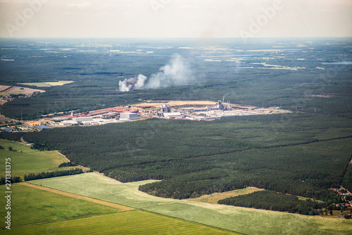 Smoke clouds and fire spread of a fire in the trees / forest - aerial view - for Canvas Print