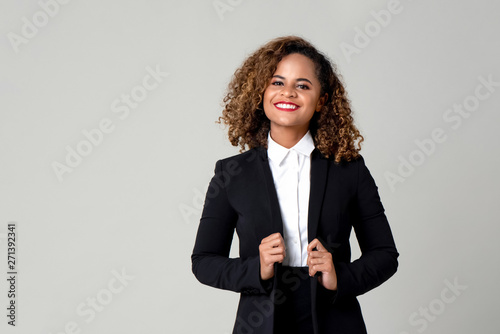 Happy smiling African American woman in formal business attire Canvas Print