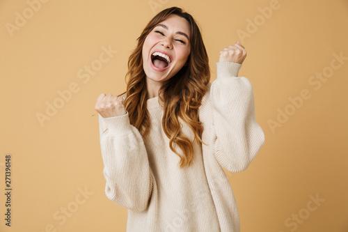 Obraz Beautiful young woman wearing sweater standing - fototapety do salonu