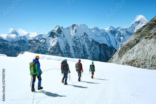 Fényképezés Climbers reaches the summit of mountain peak