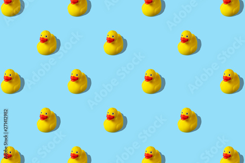 Obraz na plátně Trendy summer pattern with yellow rubber duck on bright blue background