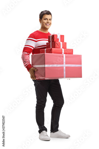 Young man holding a pile of presents