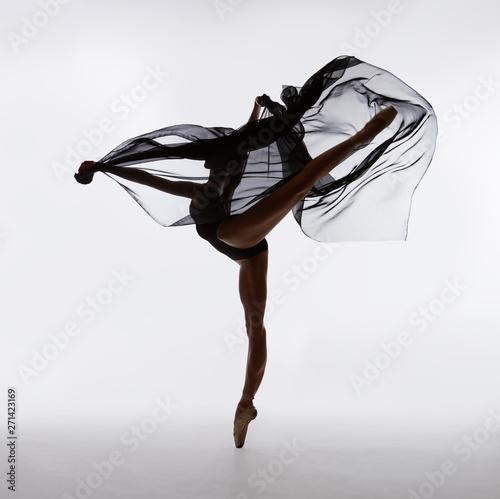 Fotografie, Obraz A ballerina dances with a black cloth
