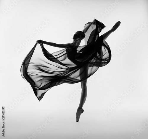 Photographie A ballerina dances with a black cloth