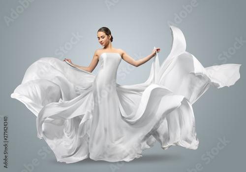 Fashion portrait of a beautiful woman in a waving white dress Slika na platnu