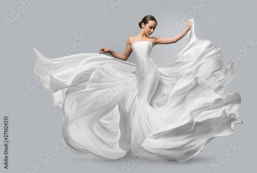 Fotografija Fashion portrait of a beautiful woman in a waving white dress