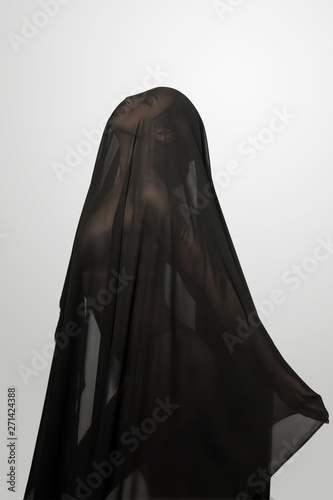 Canvas Print Girl in a black transparent veil on the face