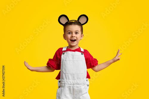 Fényképezés  Cheerful girl with mouse ears