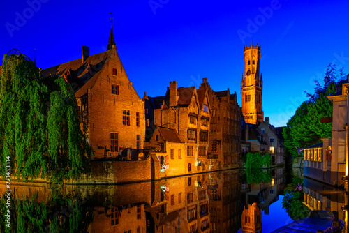 Wall Murals Bridges Classic view of the historic city center with canal in Brugge, West Flanders province, Belgium. Night cityscape of Brugge.