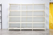 Hand made White shelves made from Slotted Angle Steel bar Placed in a white warehouse.