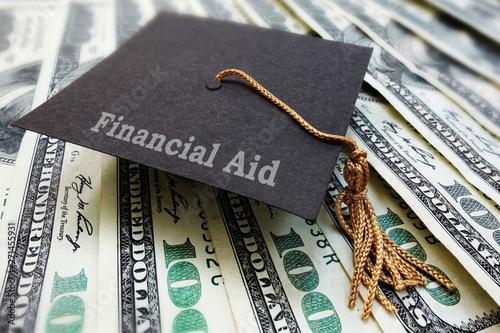 Fotografie, Tablou Financial Aid graduation cap on money