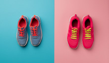 A Studio Shot Of Running Shoes On Bright Color Background. Flat Lay.